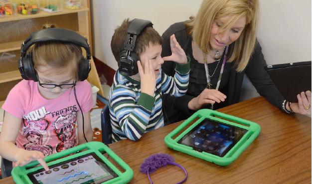 Kindergarten teacher with Students on iPads